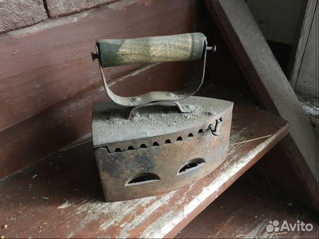 Старинный утюг паровоз фото